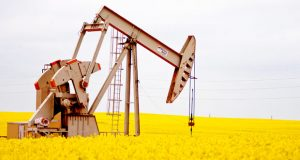 OIL-PUMP-AND-CANOLA-FIELD-mike-kopp-620x330